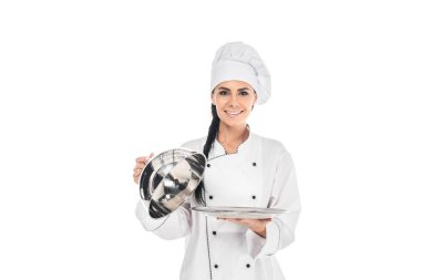 Chef in hat holding tray with cloche isolated on white stock vector