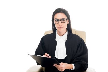 Judge sitting in armchair and holding clipboard isolated on white