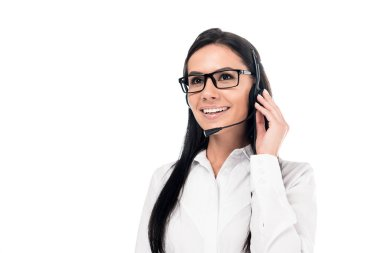 Smiling call center operator in glasses touching headset isolated on white stock vector