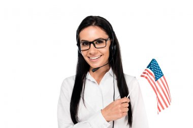 Smiling call center operator in glasses holding american flag isolated on white