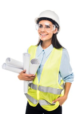 Engineer in hardhat and goggles holding blueprints isolated on white