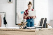 Selective focus of teenager in jeans and table with notebooks