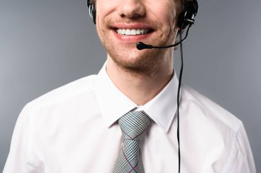 Cropped view of smiling call center operator in headset stock vector