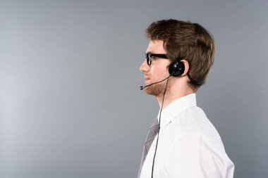 side view of confident call center operator on grey background