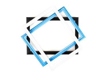 Top view of three frames on white surface