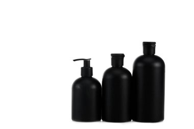 Black cosmetic bottles with spray and caps isolated on white