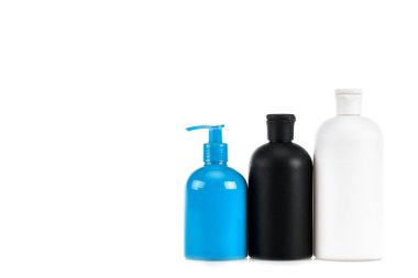 Three cosmetic bottles with spray isolated on white