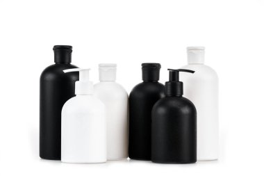 Black and white cosmetic bottles isolated on white stock vector