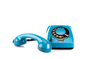 Blue vintage telephone with handset and wire on white stock vector