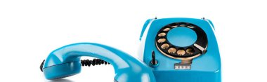 Panoramic shot of blue vintage telephone with handset and wire on white