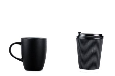 Black ceramic cup and paper cup of coffee isolated on white