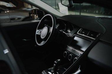 Black steering wheel near gear shift in luxury car stock vector