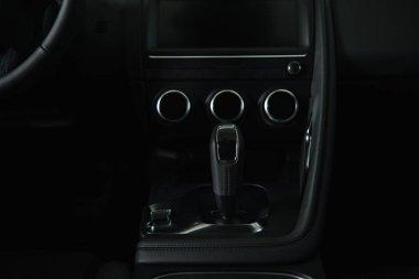 modern black gear shift near buttons in luxury car