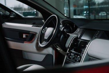 buttons near black steering wheel in luxury car