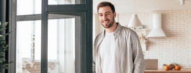 Panoramic shot of smiling bearded man in checkered shirt looking at camera stock vector