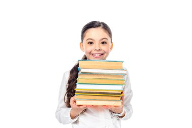 Smiling schoolgirl holding books and looking at camera Isolated On White stock vector