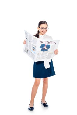 Adorable schoolgirl in formal wear and glasses reading business newspaper On White stock vector