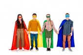 happy kids in superhero costumes and masks holding hands On White