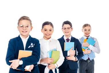 happy schoolchildren pretending to be businesspeople with books Isolated On White