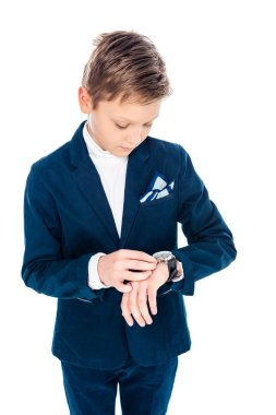 Schoolboy in formal wear pretending to be businessman adjusting watch Isolated On White stock vector