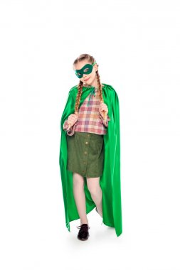 Kid in superhero costume and mask posing Isolated On White stock vector
