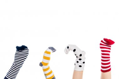 cropped view of people with colorful sock puppets on hands Isolated On White with copy space
