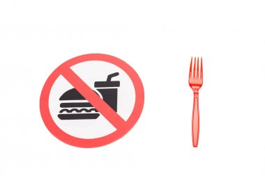 no food and drinks sign near plastic fork isolated on white