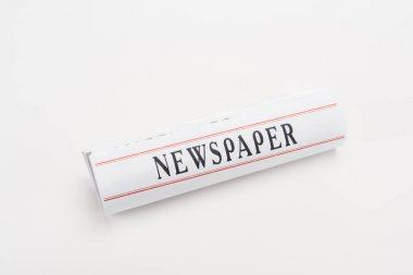 rolled print newspaper on white background with copy space