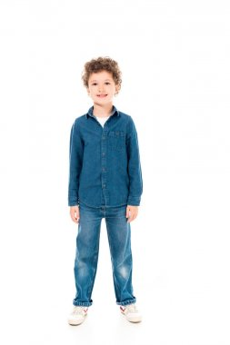 Full length view of smiling kid in denim clothes isolated on white stock vector