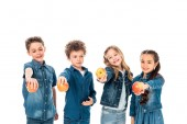 four children in denim clothes holding apples isolated on white