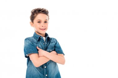 Smiling kid in denim shirt posing with crossed arms isolated on white stock vector