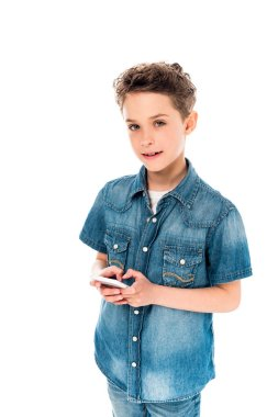 Smiling kid in denim shirt using smartphone isolated on white stock vector