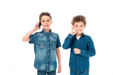 Front view of two kids talking on smartphones isolated on white stock vector