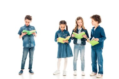 full length view of four concentrated kids reading books on white