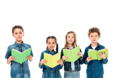 four kids in denim clothes holding books isolated on white