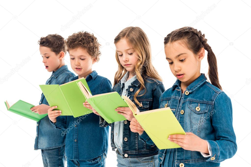 Four amazed children in denim clothes reading books isolated on white stock vector