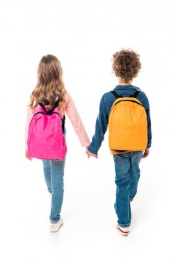 back view of schoolchildren with backpacks holding hands isolated on white