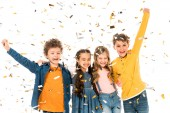 four happy kids waving hands under confetti isolated on white