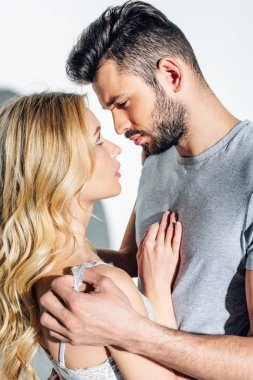 Handsome bearded man looking at attractive blonde woman on white stock vector