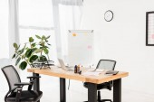 Photo modern office with white board, plant and laptop on desk