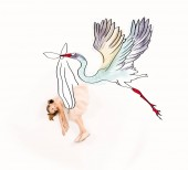 Fotografie top view of stork carrying cheerful kid in pink dress on white