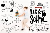 Fotografia top view of kid near colorful books and welcome back to school lettering on white