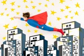 top view of kid in super hero costume flying near stars and buildings on white