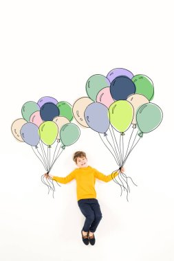 Top view of happy kid holding colorful balloons and smiling on white stock vector