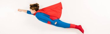 Panoramic shot of adorable kid in super hero costume flying on white stock vector