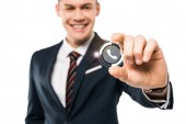 Photo selective focus of happy businessman gesturing and smiling while touching virtual phone icon isolated on while