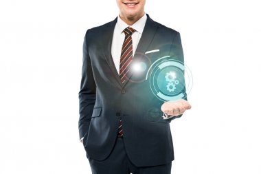 Cropped view of cheerful man in suit smiling and gesturing near cogwheel icon on white stock vector