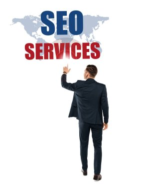 Back view of man pointing with finger at seo services lettering while standing isolated on white stock vector