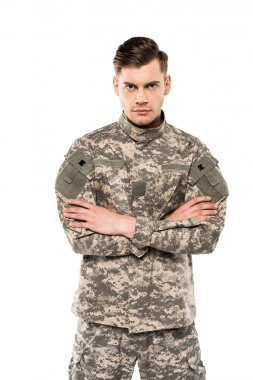 Serious soldier in uniform standing with crossed arms isolated on white stock vector