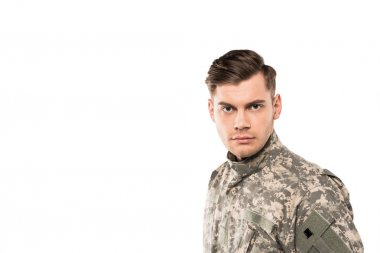 Serious and handsome soldier in uniform looking at camera isolated on white stock vector